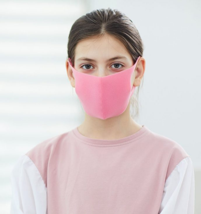 Unrecognizable Girl In Face Mask